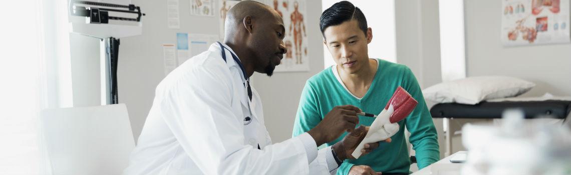 doctor explaining knee model to patient