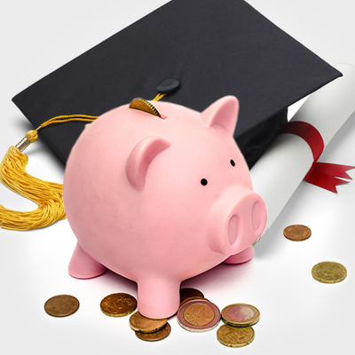 a piggy bank and a graduation cap with coins around them