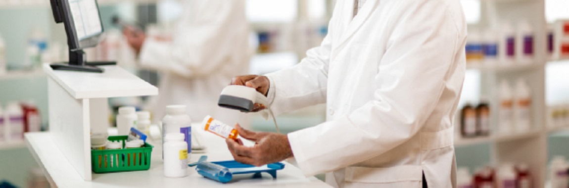 Pharmacist scanning a prescription container