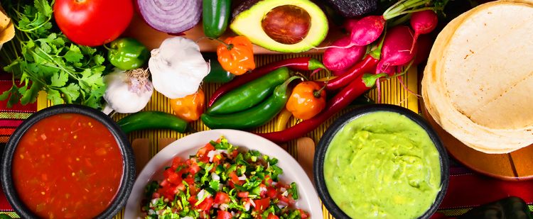 table of salsa and guacamole ingredients