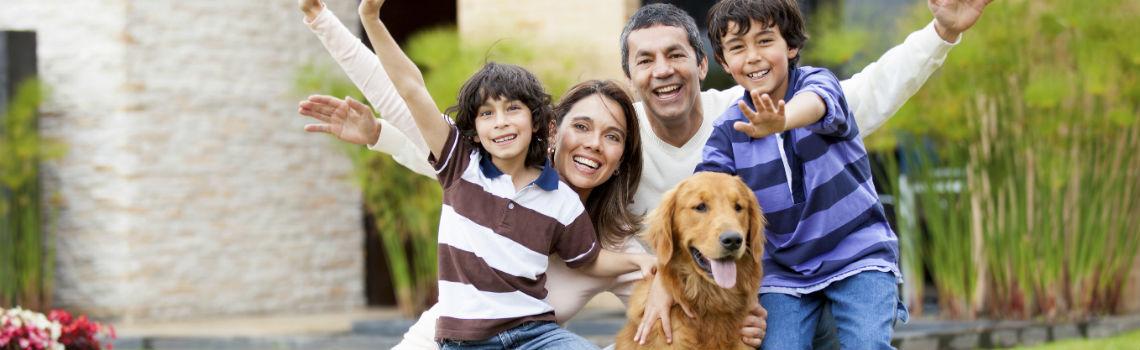 A family of four with their cute golden retriever