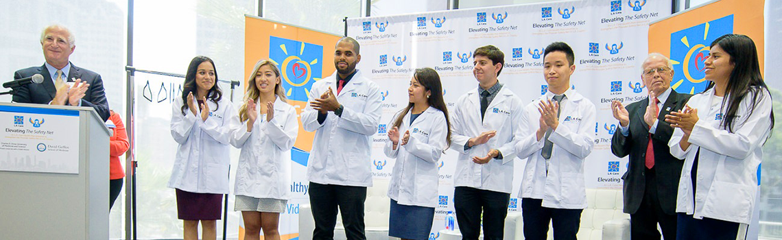 seven of the scholarship recipients with Richard Seidman and John Baackes of L.A. Care onstage at launch event