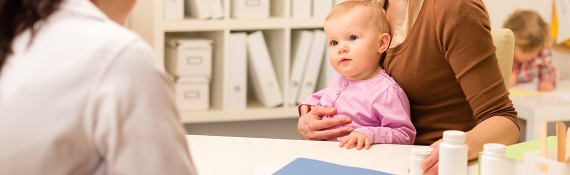 Young woman with baby girl visit pediatrician office for medical check-up
